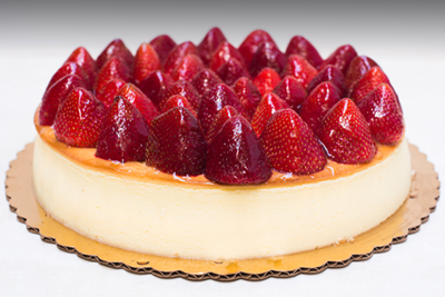 Veniero's Strawberry New York Cheesecake, handmade in Manhattan with the same Italian recipe since 1894. Enjoy the best creamy cheesecake in the cafe with a fresh cup of coffee, or get it delivered anywhere in the US.